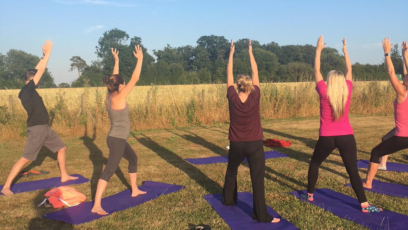 yoga class outside in meadow, Bradfield St George