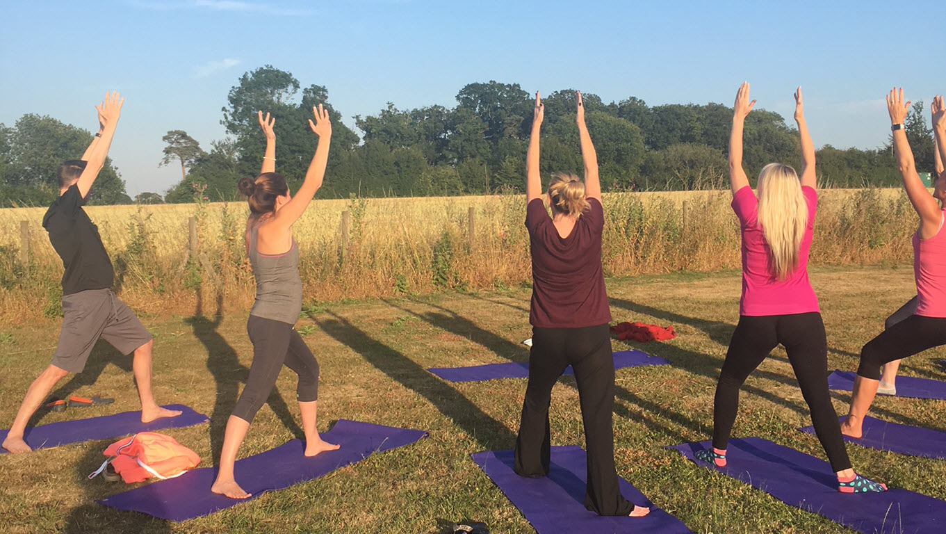 yoga class outside in meadow, Bradfield St George
